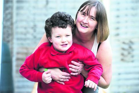 Four-year-old Mason Haley with his mum Tina at home in Compton Bassett