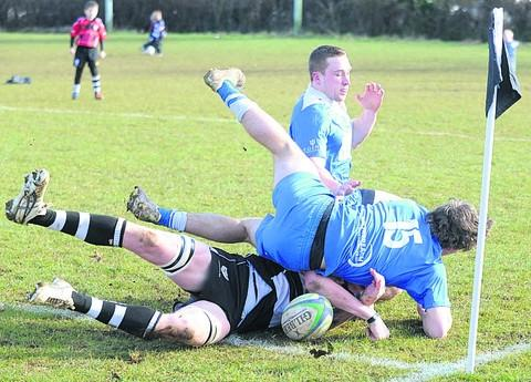 Chippenham captain Bobby Lyons (black and white) goes over for his side's first try in their 37-24 triumph over Weston super Mare in National Three South West on Saturday