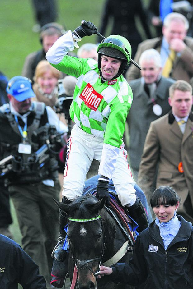 Wiltshire jockey Wayne Hutchinson celebrates on Medinas after winning the Coral Cup for Barbury Castle trainer Alan King