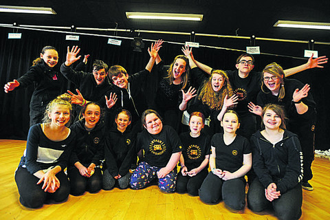 Young performers from Marlborough Stagecoach get ready for their show at the National Indoor Arena, near Birmingham