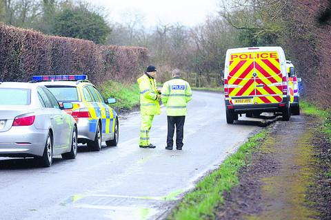 Police at the scene of the fatal accident on Friday