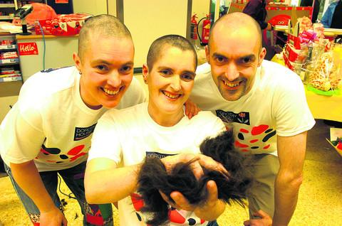 Karen Doling with brother Roger and sister Jo after their head shaves