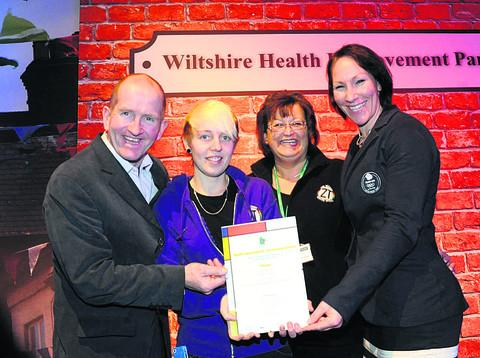 Eddie the Eagle and Debbie Flood present Bea Potter and Nicola Sage with their award
