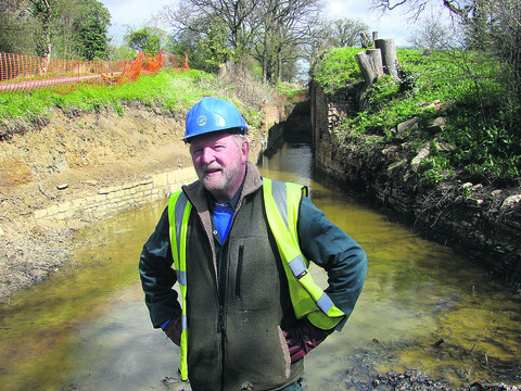 Wilts & Berks Canal Trust director Colin Fletcher in front of the derelict Pewsham Locks