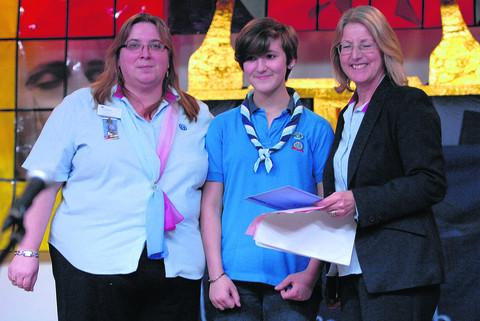 Wiltshire South County Commissioners for Girlguiding, Shirley Eve, left, and Diane Boualt, right, present Connie Fiducia-Brookes with her Baden Powell award