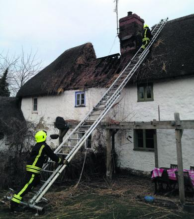 Firefighters at the scene of yesterday's blaze