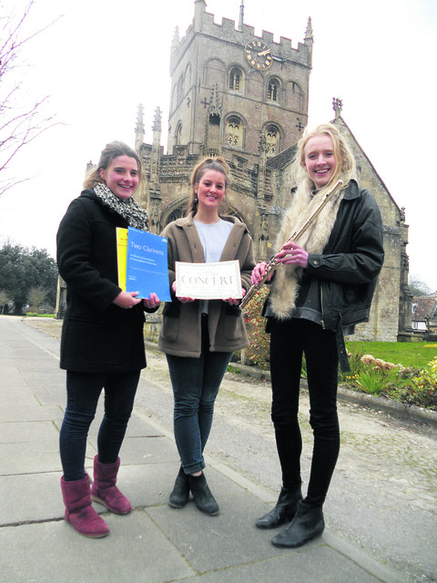 Phoebe Heaton-Renshaw, Izzy Winter and Elen Pigott prepare for the concert at St John's Church on  April 13