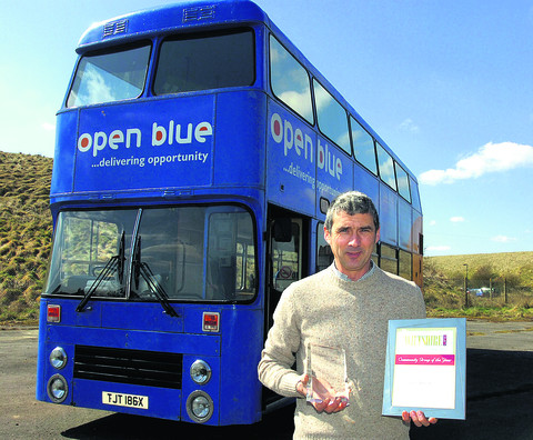 Andy Weeds, director of Open Blue, with the award