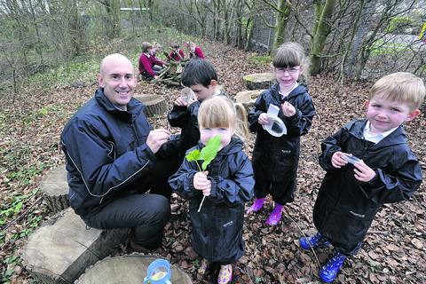 The Wiltshire Gazette and Herald: Anthony Welch and pupils enjoy the award-winning woodland learning area.