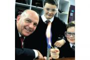 Mr Croxford with Harry Melling and Oliver Corfield in a science lesson.