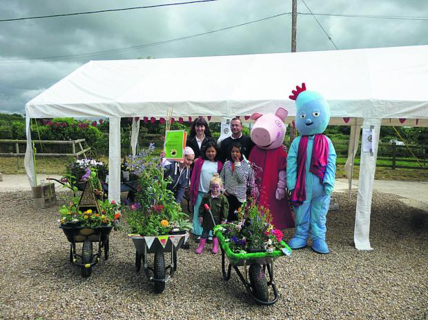 Winning wheelbarrows from Easton Royal, Woodborough and Chirton with Peppa Pig and Iggle Piggle at the  garden centre's Strawberry Fayre