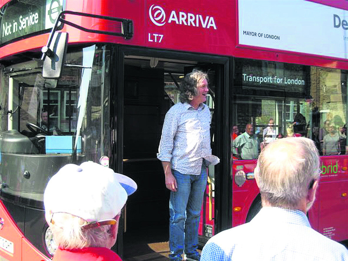 James May greets well wishers as he arrives in Lacock in a London bus