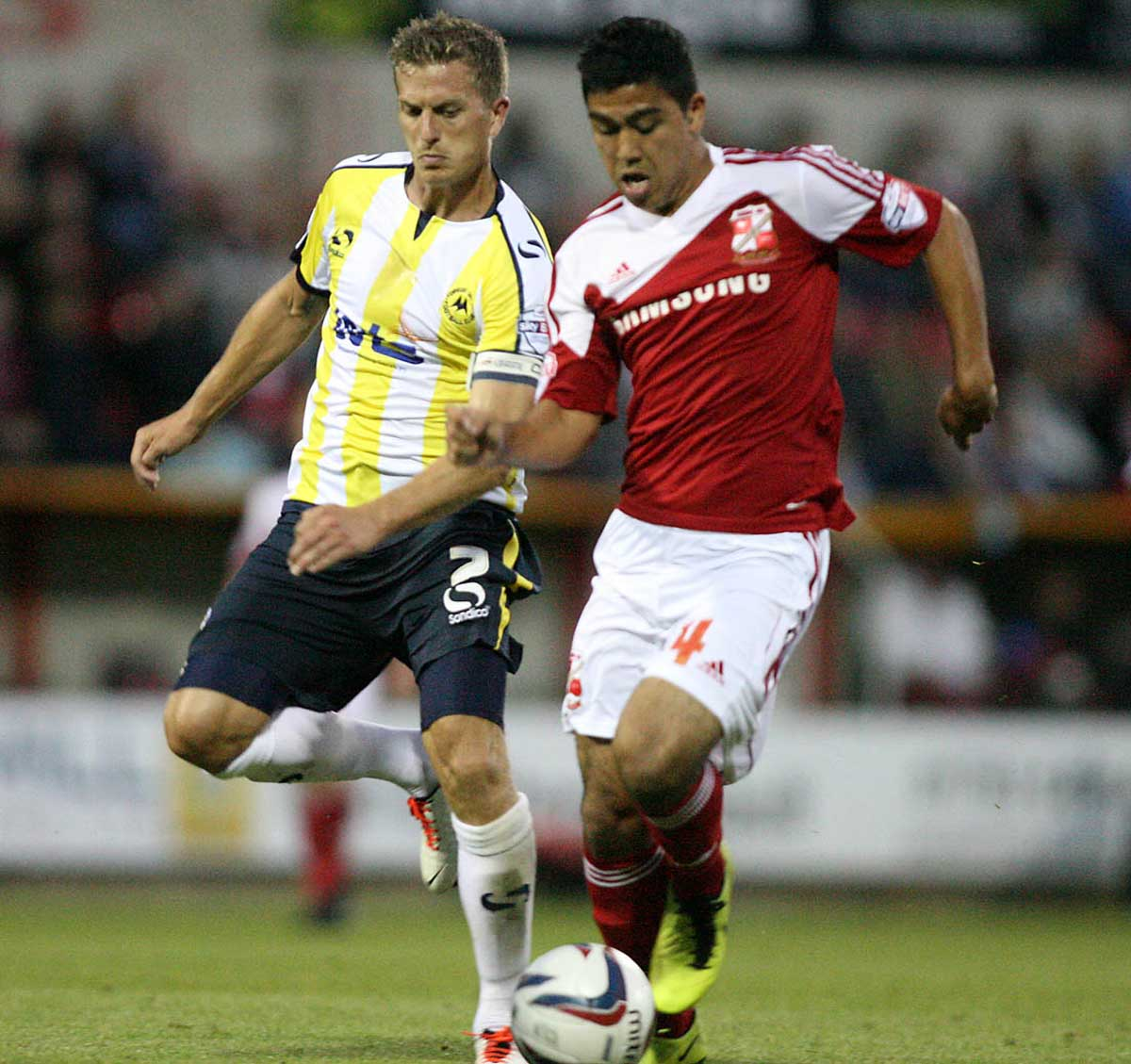 Town's Massimo Luongo, right