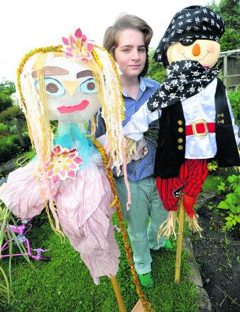 Matthew Wilson gets ready to unveil the first Hilcott scarecrow trail
