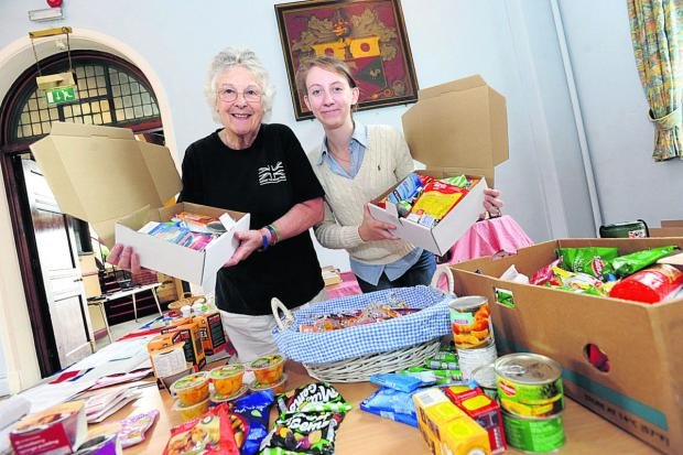 From left are Nickie Phillipson-Stoy and organiser Ellie Vesey-Thompson, packing goods for troops                  (DV623) By DIANE VOSE