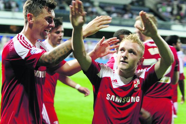 The Wiltshire Gazette and Herald: Swindon's Alex Pritchard scores Swindon's second goal of the evening to beat QPR 2-0 in the League Cup