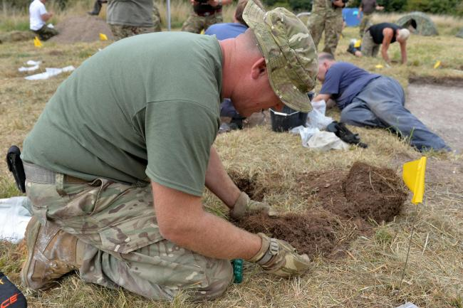Cpl Steve Blake painstakingly helps to uncover the Spitfire