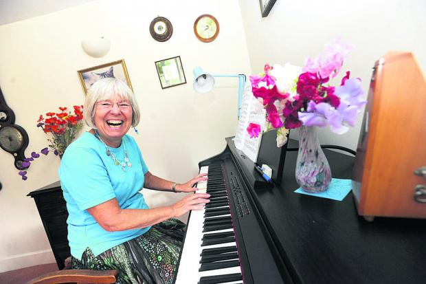 The Wiltshire Gazette and Herald: Maggie Dyson plays the piano at Dyrham Park, near Bath, on Saturday