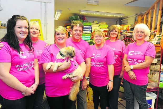 Rangebourne Pet Care staff, from left, Emeline Sheppard, Kala Ainsley, Jade Britten, Andy Sheppard, Jo Sheppard, Jane Horrocks and charity member Bo Miles-Hobbs  (DV712) By DIANE VOSE