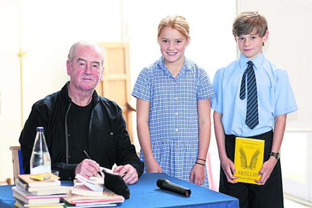 David Almond with pupils