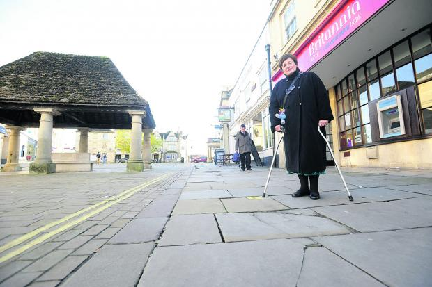 Coun Mary Fallon conducts a survey of uneven pavements in Chippenham