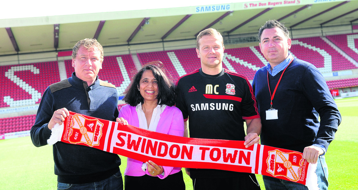 Lee Power, far left, pictured with director Sangita Shah, manager Mark Cooper and former Town chairman Jed McCrory