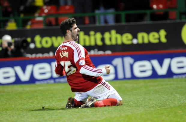 The Wiltshire Gazette and Herald: Yaser Kasim celebrates his goal against Coventry