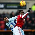 The Wiltshire Gazette and Herald: Nile Ranger challenges with Coventry's Dan Seabourne