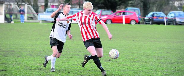Devizes Town's Jack Fisher in possession during his side's victory over Corsham Town