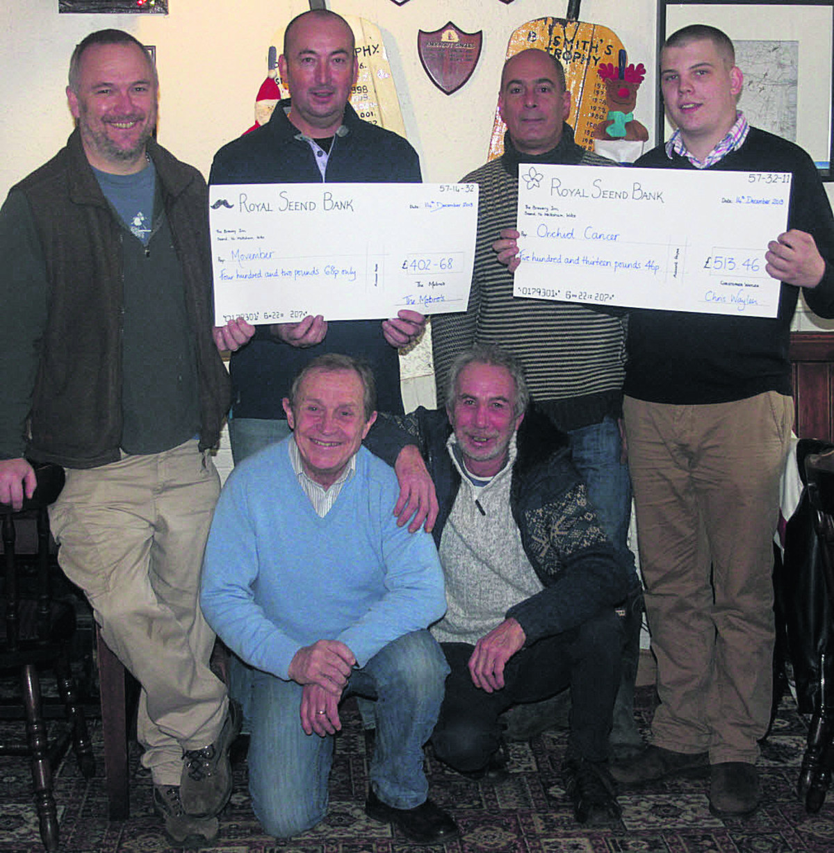 Fundraisers Mick Grist, Paul Shellard, Raf Mattar and Chris Waylen, front, Norman Fry, landlord of the Brewery Inn, and Steven Foskett raised £916 for male cancer charities