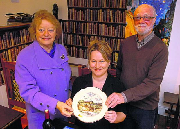 Rebecca Wood, owner of the Mayenne cafe in Devizes, centre, with, Margaret Taylor and Jasper Selwyn, of Devizes Twinning Association, and the new plate showing Mayenne