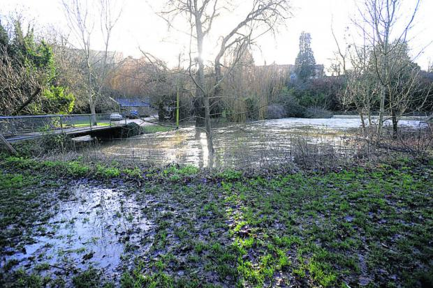 The Wiltshire Gazette and Herald: The water levels near the lower car park in Malmesbury y