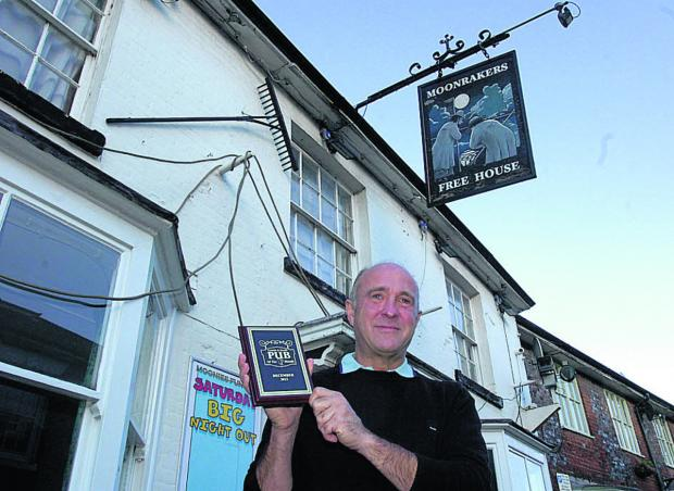 Jerry Kunkler with his Pub of the Month award