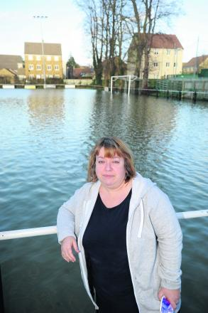 Malmesbury Victoria secretary Julie Exton at the flooded Flying Monk Ground this week