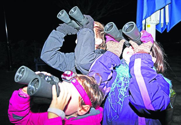 The Wiltshire Gazette and Herald: Variety Millett, Tim Jones and Katherine Jones look to the heavens