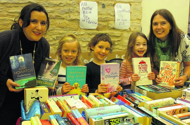 The Wiltshire Gazette and Herald: Leisa Watson, Lottie, Libby, Martha and Julia Pugh run a book stall at the first Sherston market