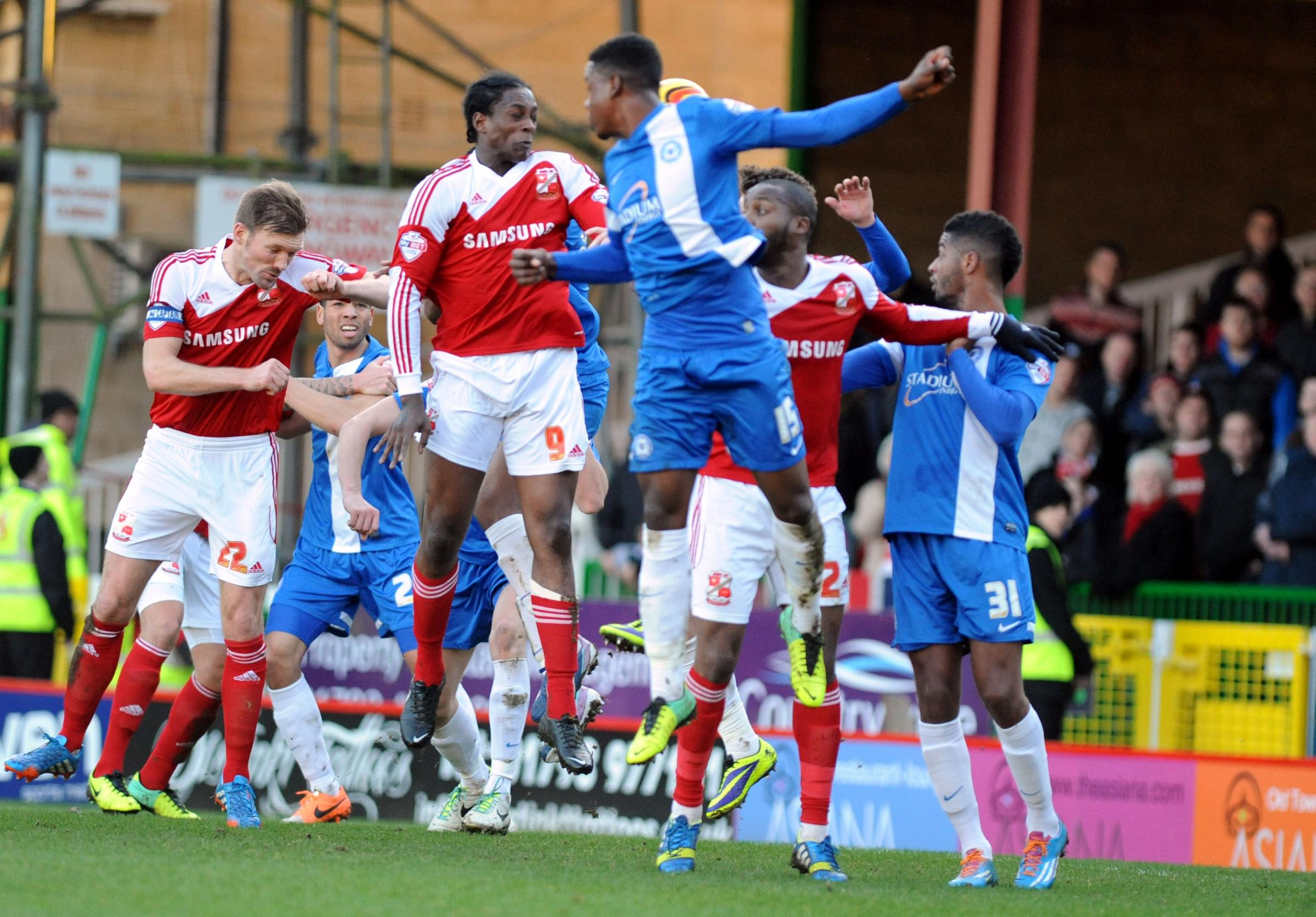 SWINDON TOWN 2 PETERBOROUGH UTD 1: Swindon's Balotelli does it again