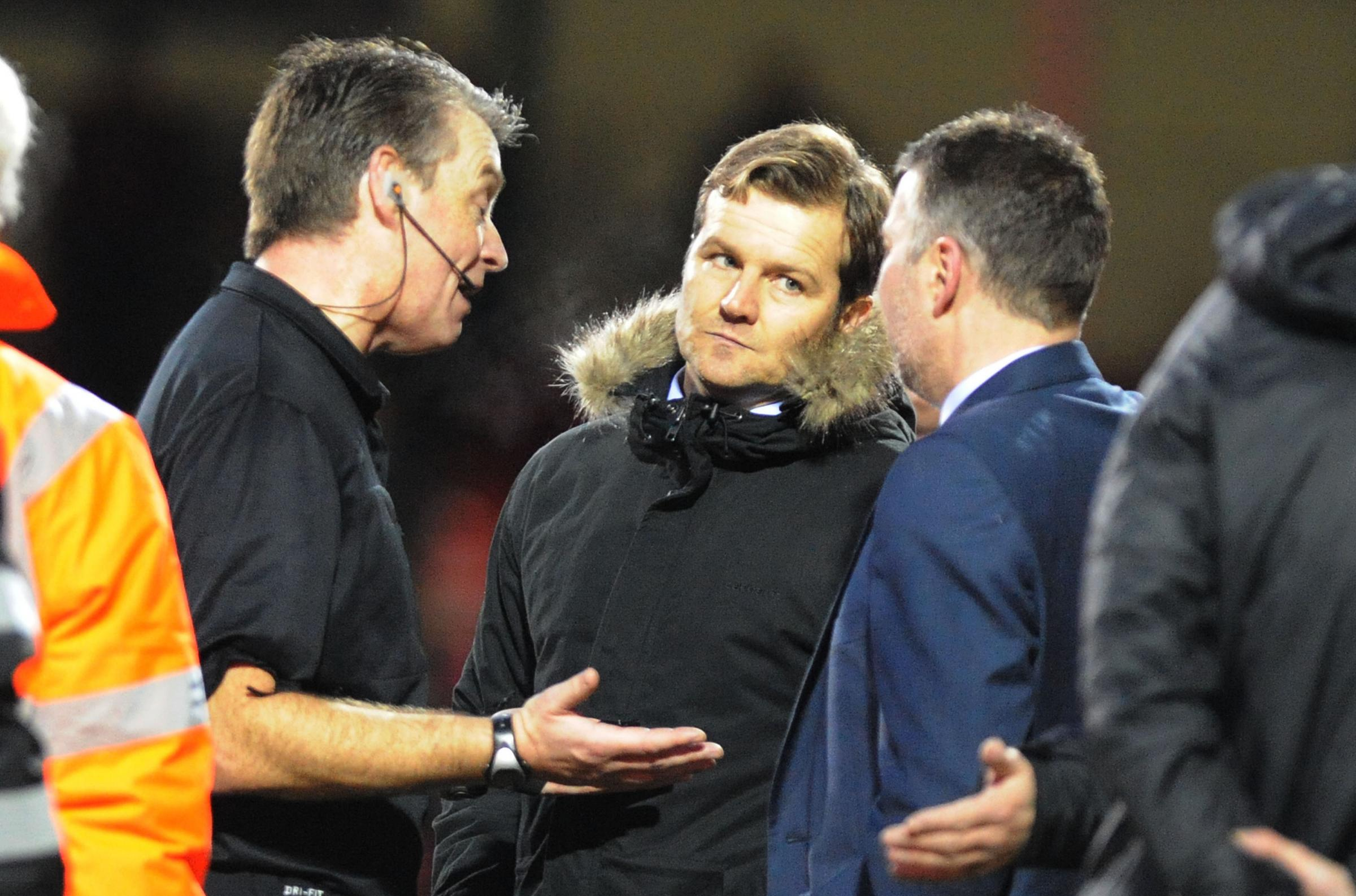 Mark Cooper shares a look with Peterborough boss Darren Ferguson
