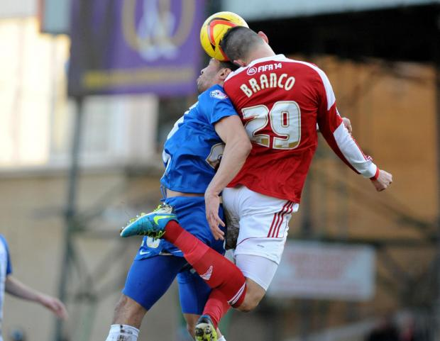 The Wiltshire Gazette and Herald: Raphael Rossi Branco wins a header during his star performance in Swindon Town's victory over Peterborough