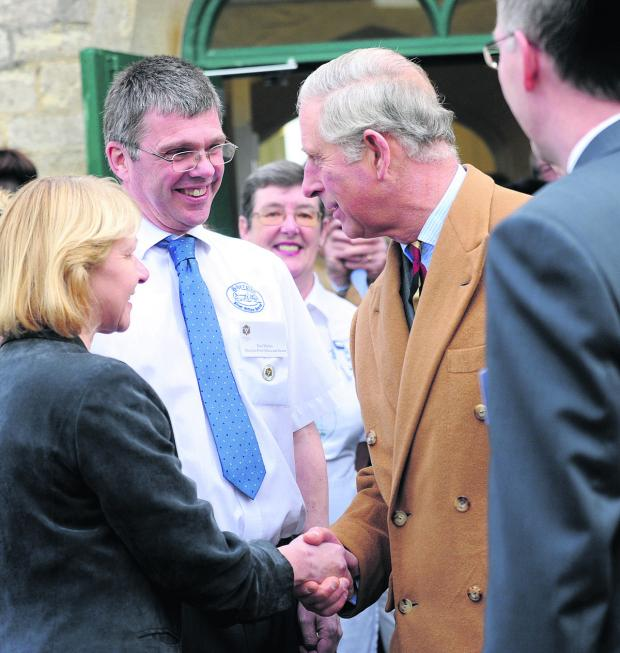 The Wiltshire Gazette and Herald: Prince Charles meets Gail and Paul Mather outside Sherston Post Office during his visit to the Old School Project in November last year