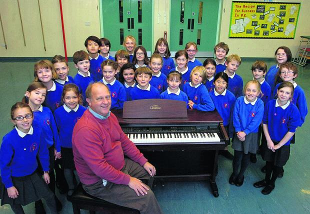 Headteacher Nick Bowditch with the school choir