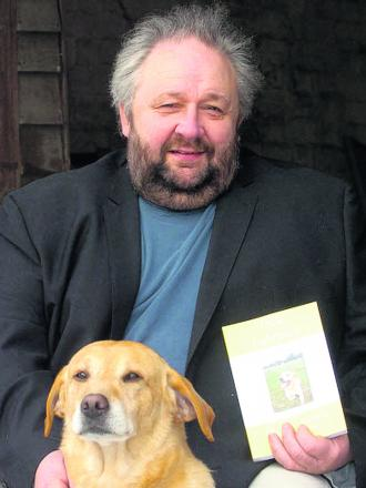 Adrian Elmer with his faithful labrador Jack
