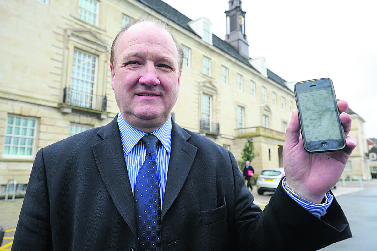 Coun Philip Whitehead with the new app, which he promises will be improved