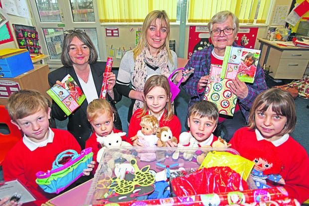 Back from left, Janice Charlton, St Barnabas headteacher Jill Hibbs and Ursula McKinnon with, front, Charlie, Martha, Jessica, Aaron and Lizzie