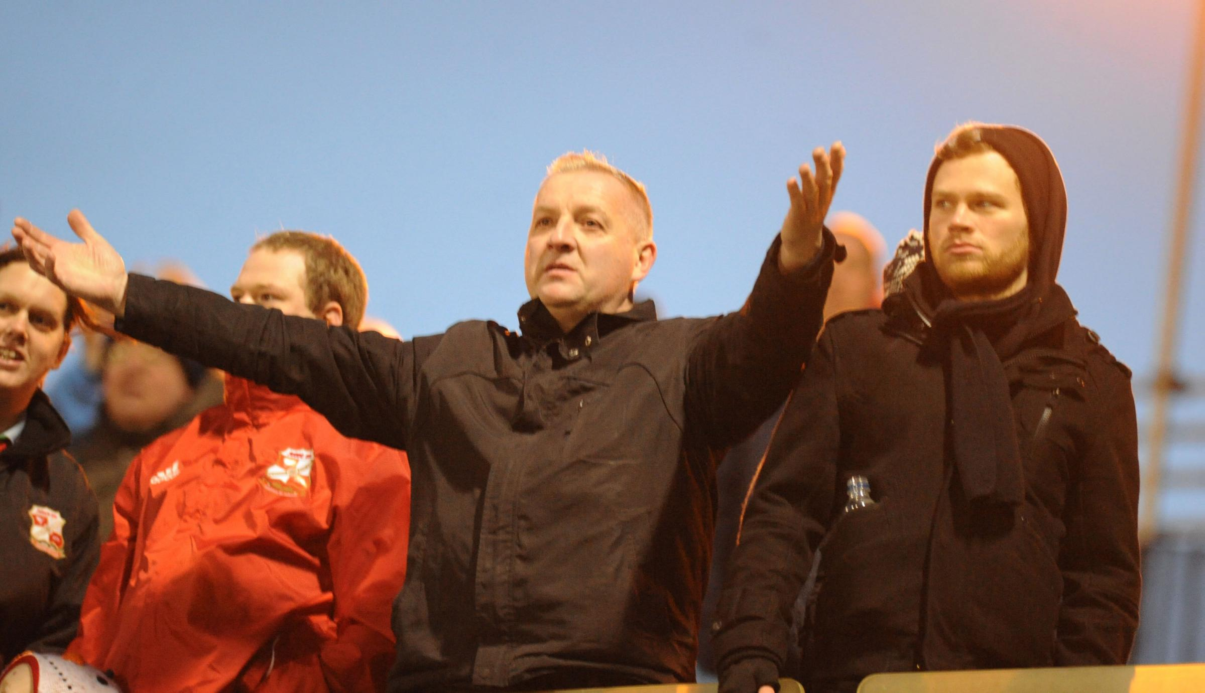A Swindon Town fan shows his frustration at Gillingham on Saturday