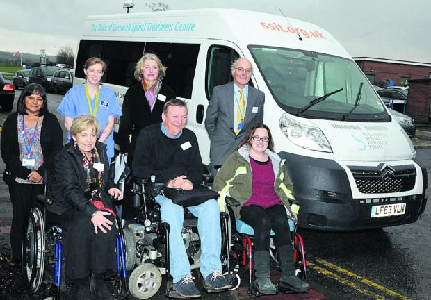 Staff and patients with the new minibus at the Duke of Cornwall Spinal Treatment Centre
