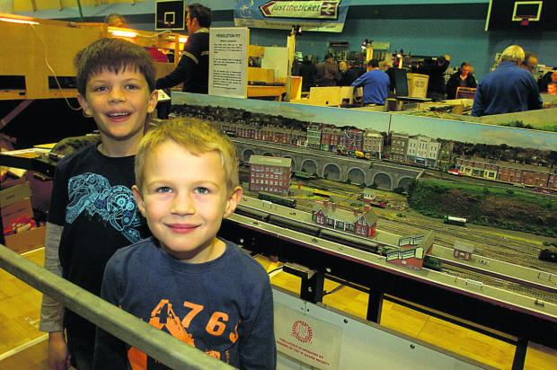 The Wiltshire Gazette and Herald: Jacob and Ethan Sault are all smiles at Calne Model Rail Show