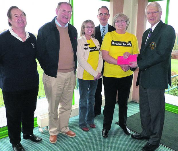 Phil Smith, Marlborough Golf Club seniors' captain elect; Dave Ferris, club seniors' chairman; Sue Lampard, Marlborough Macular Society treasurer; James Kelly, society secretary; Linda Chapman, society chairman; and Alan Pryor, club seniors' captain