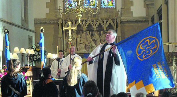 The Rev Canon Thomas Woodhouse during the dedication of the new standards
