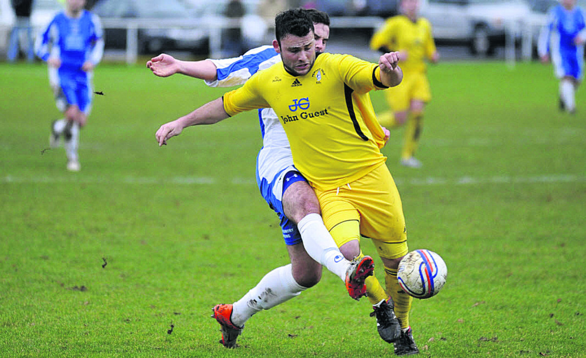 Pewsey Vale's Dave Cope battles for the ball in Saturday's Wiltshire Senior Cup tie